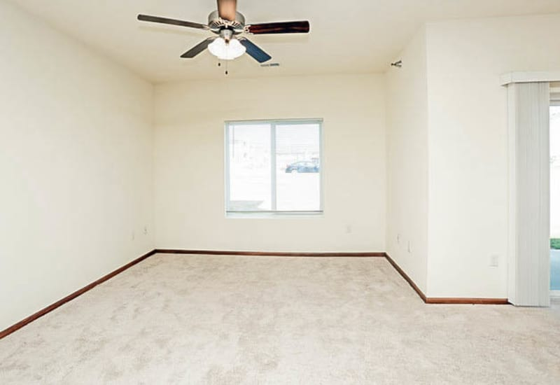 Bedroom with a ceiling fan at Johnston Heights in Johnston, Iowa