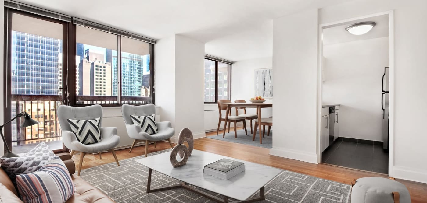 Living room with balcony access at The Ellington in New York, New York