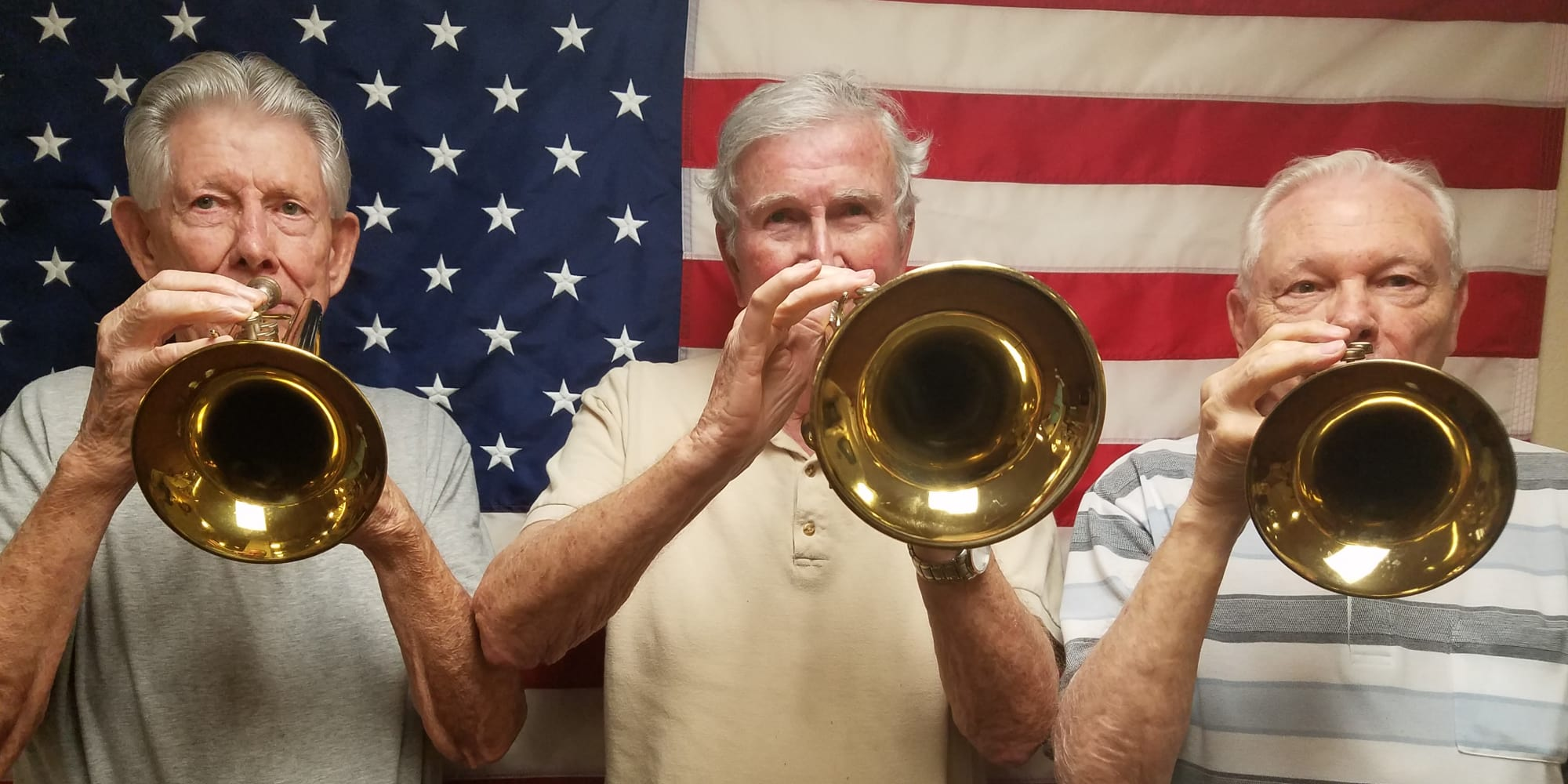 Three residents playing trumpets at The Oaks Gracious Retirement Living in Georgetown, Texas