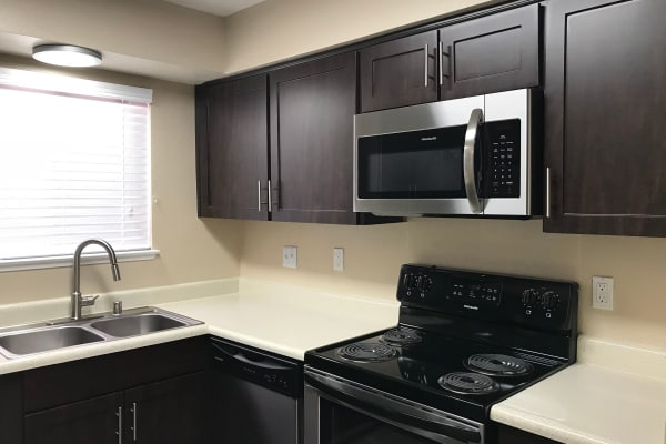 brown renovated Kitchen at Bennington Apartments in Fairfield