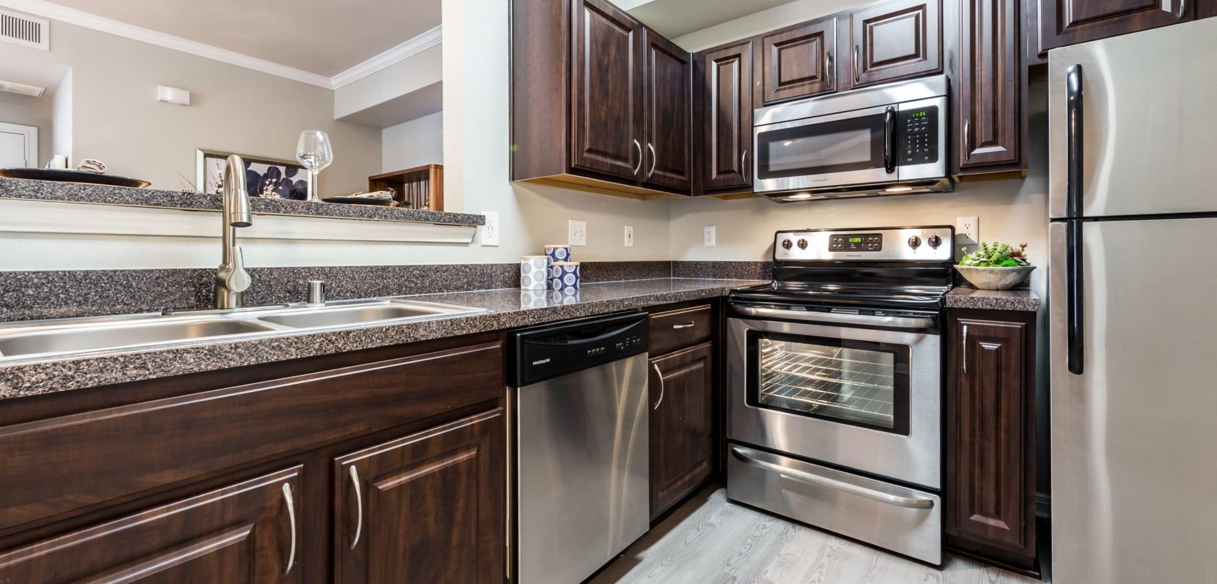 Modern kitchen with dark cabinets at Brooks on Preston in Plano, Texas