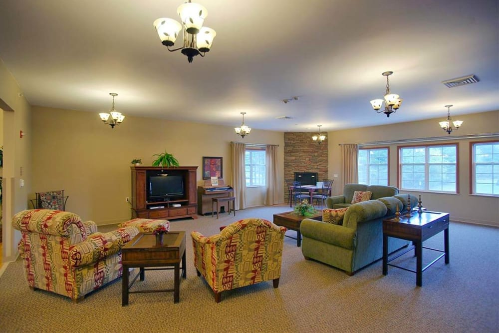 Activity room with TV and organ at Milestone Senior Living in Rhinelander, Wisconsin.