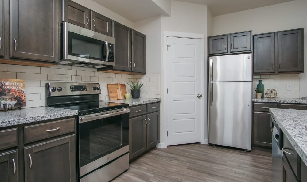 Kitchen with modern appliances and lots of cabinets storage space at Liberty Point Townhome Apartments in Draper, Utah