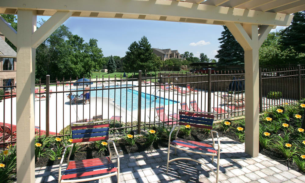 Sparkling swimming pool with sundeck on a sunny day at Saddle Creek Apartments in Novi, Michigan