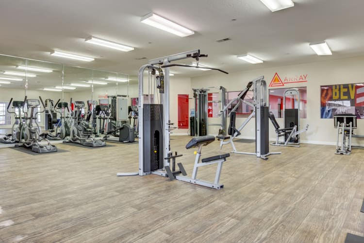 Community fitness center with individual workout stationns at Array Apartments in Austin, Texas