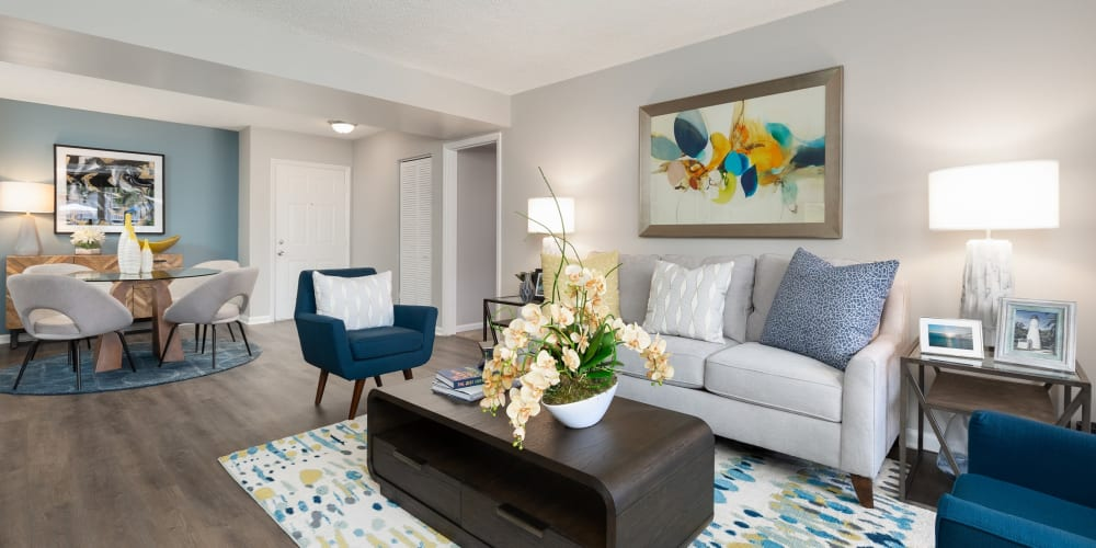 Spacious living room and kitchen area in a model home at Beach Walk at Sheridan in Dania Beach, Florida