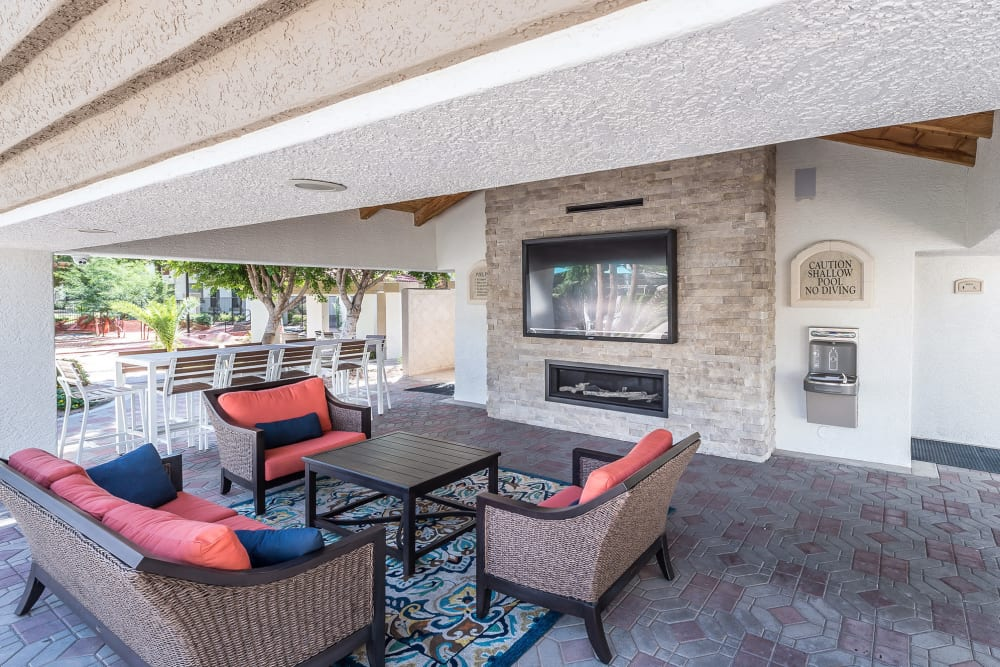 Poolside cabanas with fireplace and TV at San Palmas in Chandler, Arizona