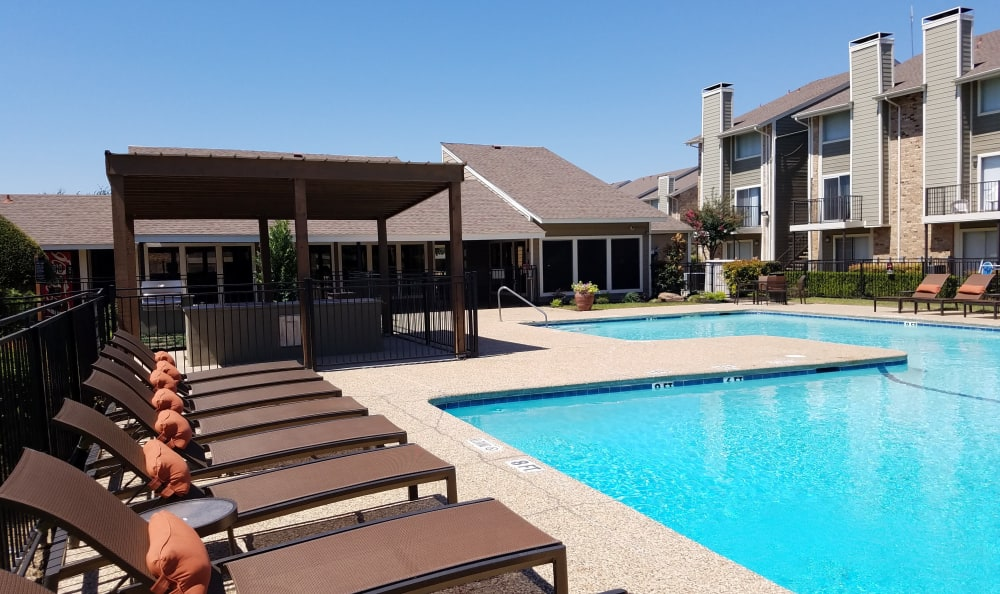 Resort-style swimming pool at Taylor Commons apartments for rent in Fort Worth, TX