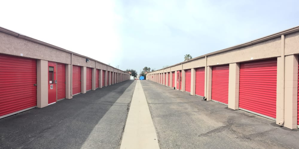 Drive-up access storage units with a wide driveway at StorQuest Express - Self Service Storage in Mesa, Arizona