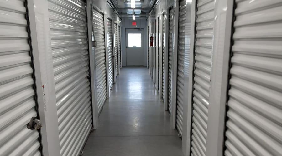 Indoor storage units with white doors at KO Storage of Billings in Billings, Montana