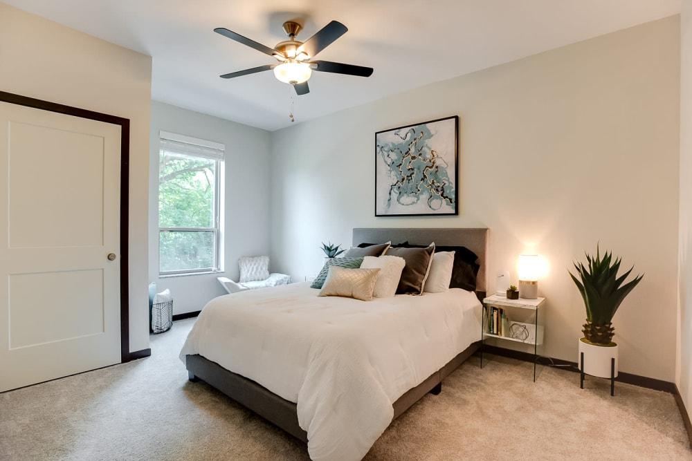 Spacious main bedroom with a large window for natural lighting at Lake Jonathan Flats in Chaska, Minnesota