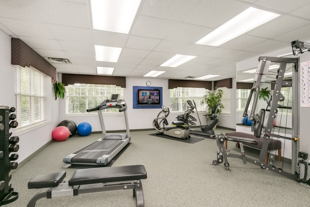 Fitness center with cardio machines at Applewood Pointe Woodbury in Woodbury, Minnesota.