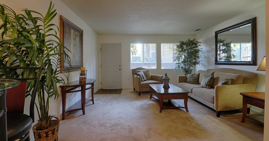 Nicely furnished living room in model home at Country Hills Apartment Homes