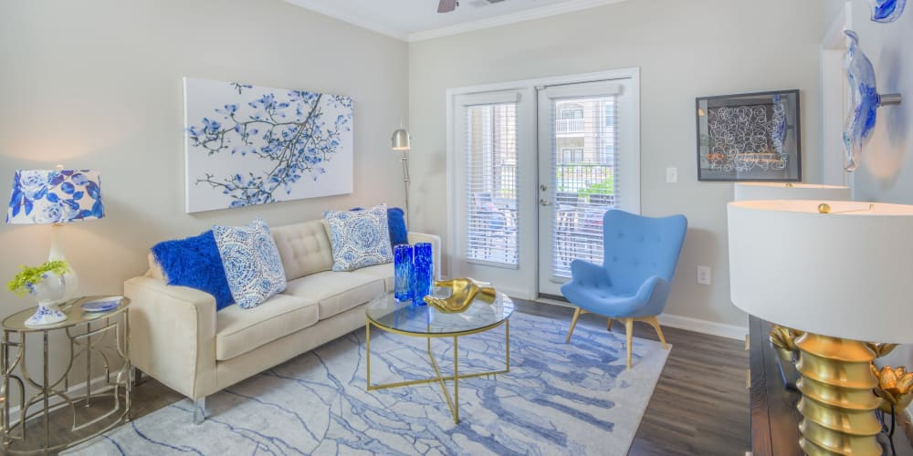 Well-furnished living room area in a model apartment at Sterling Town Center in Raleigh, North Carolina