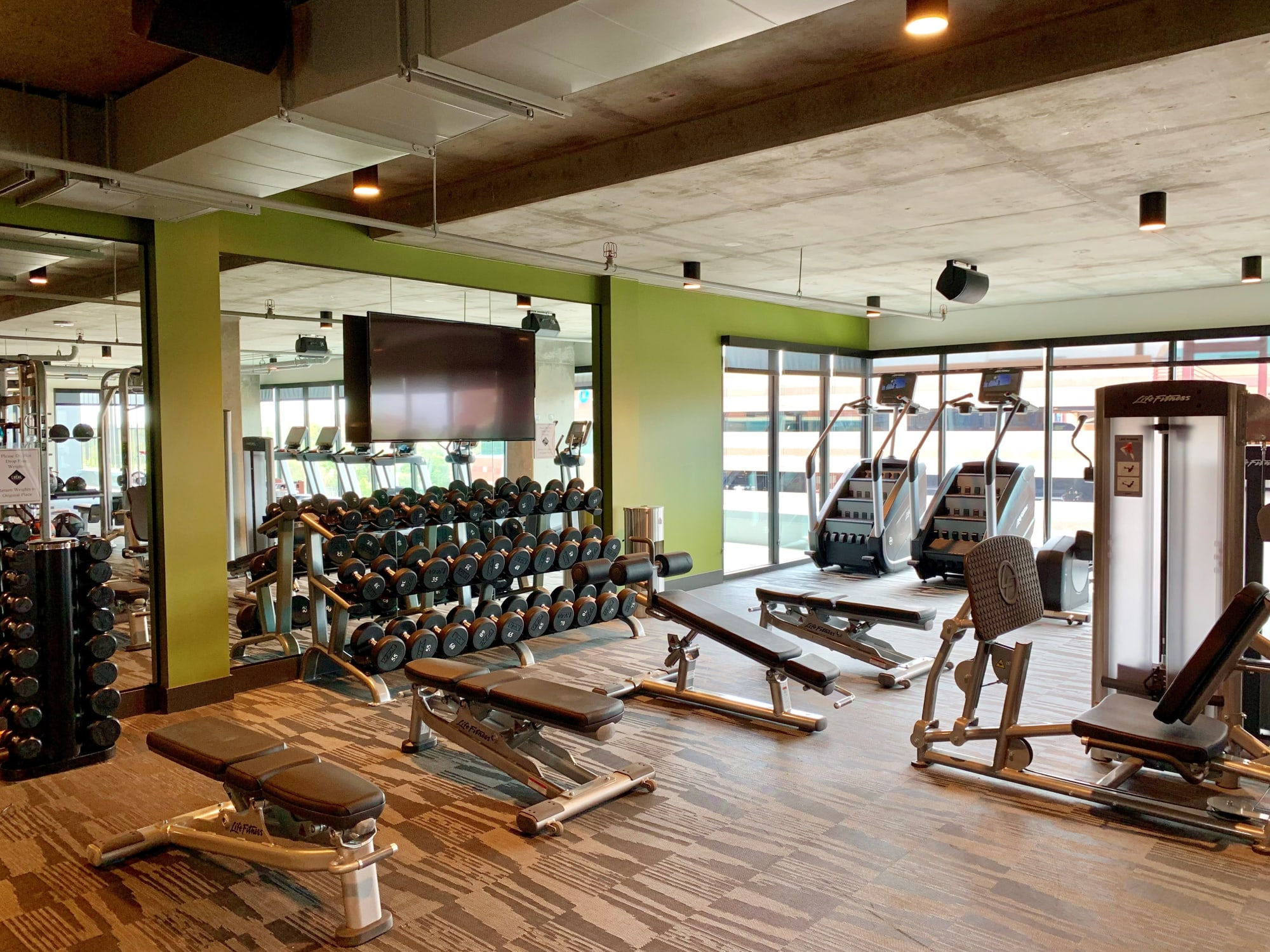 Fitness Center with equipment at The Local Apartments in Tempe, Arizona