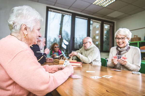 Residents playing cards at Mirror Lake Village Senior Living Community in Federal Way, Washington.