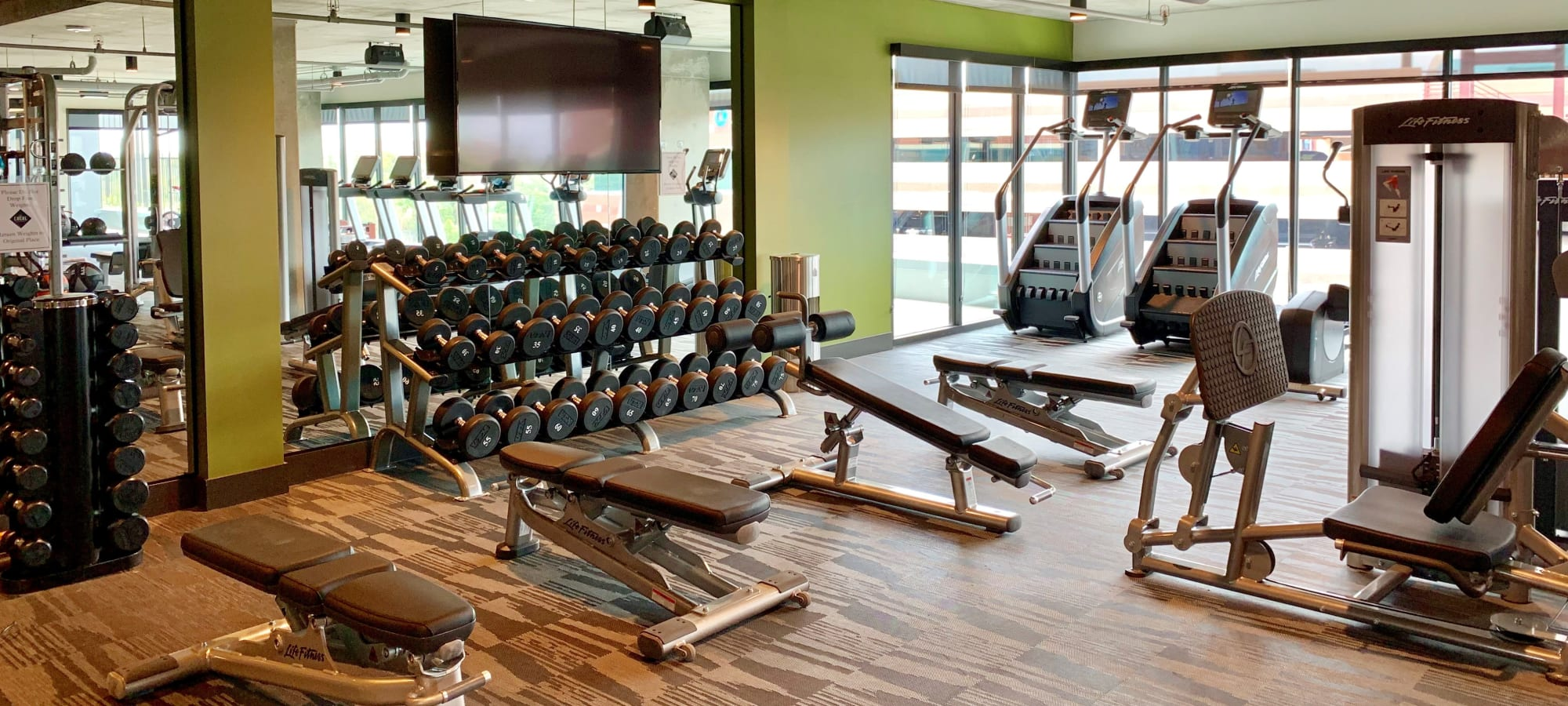 Fitness center with TV at The Local Apartments in Tempe, Arizona