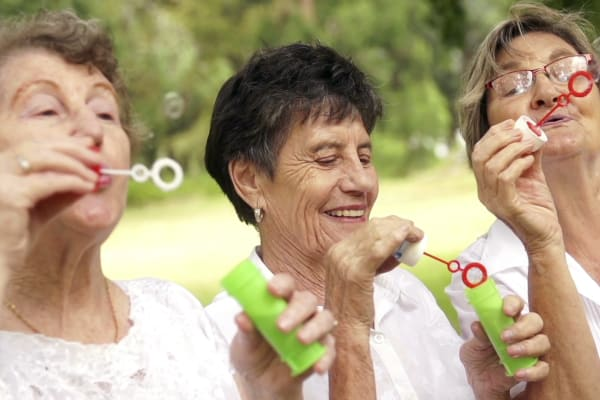 Residents blowing bubbles at Sweetbriar Villa in Springfield, Oregon