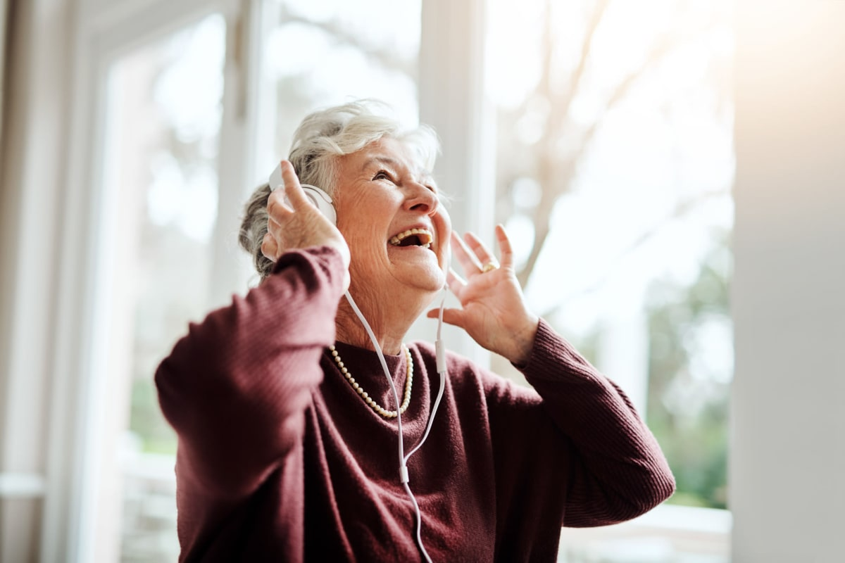 A resident listening to music at The Oxford Grand Assisted Living & Memory Care in Kansas City, Missouri