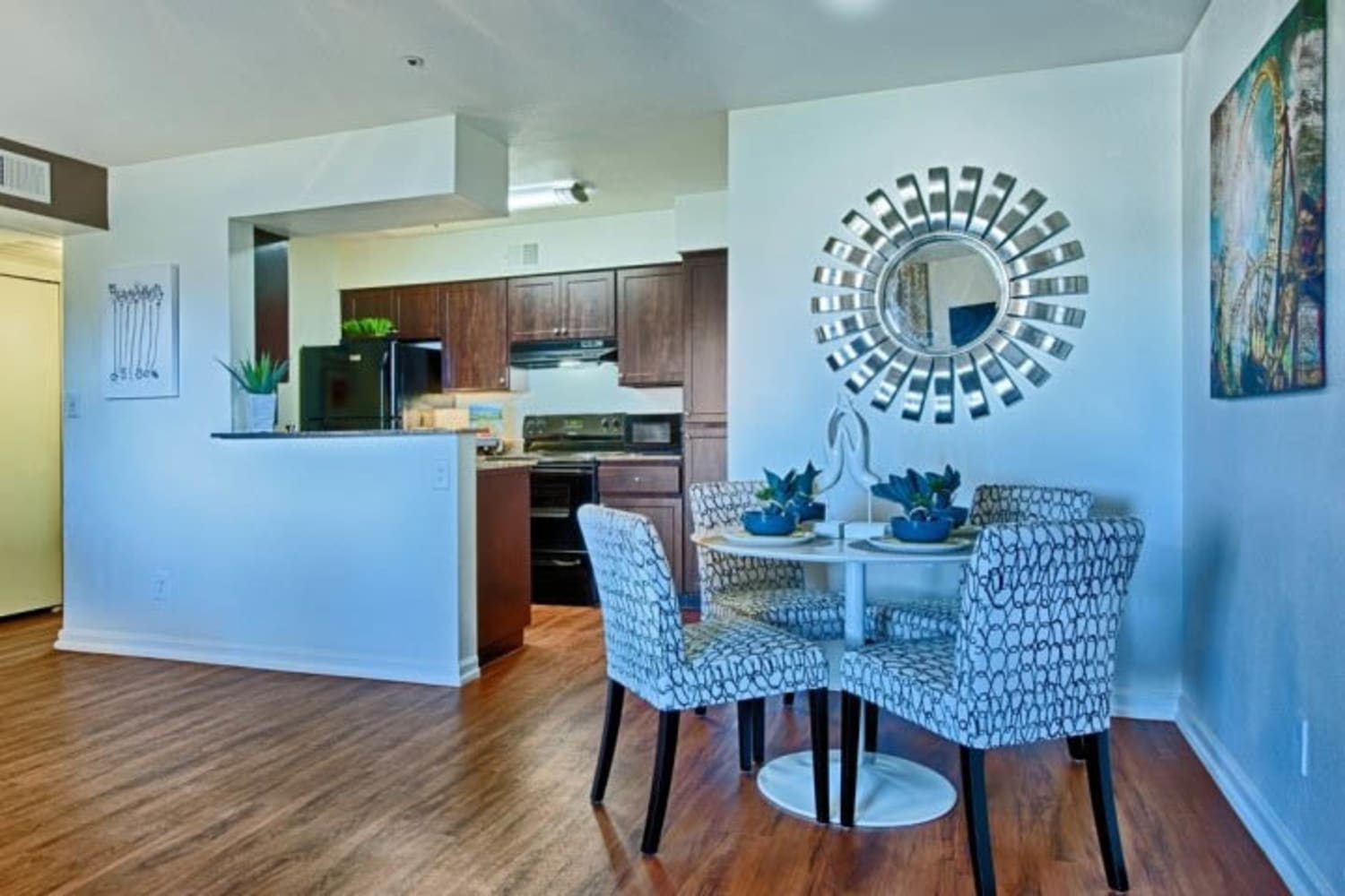 Hardwood floors in dining rooms at Cabrillo Apartments in Scottsdale, Arizona