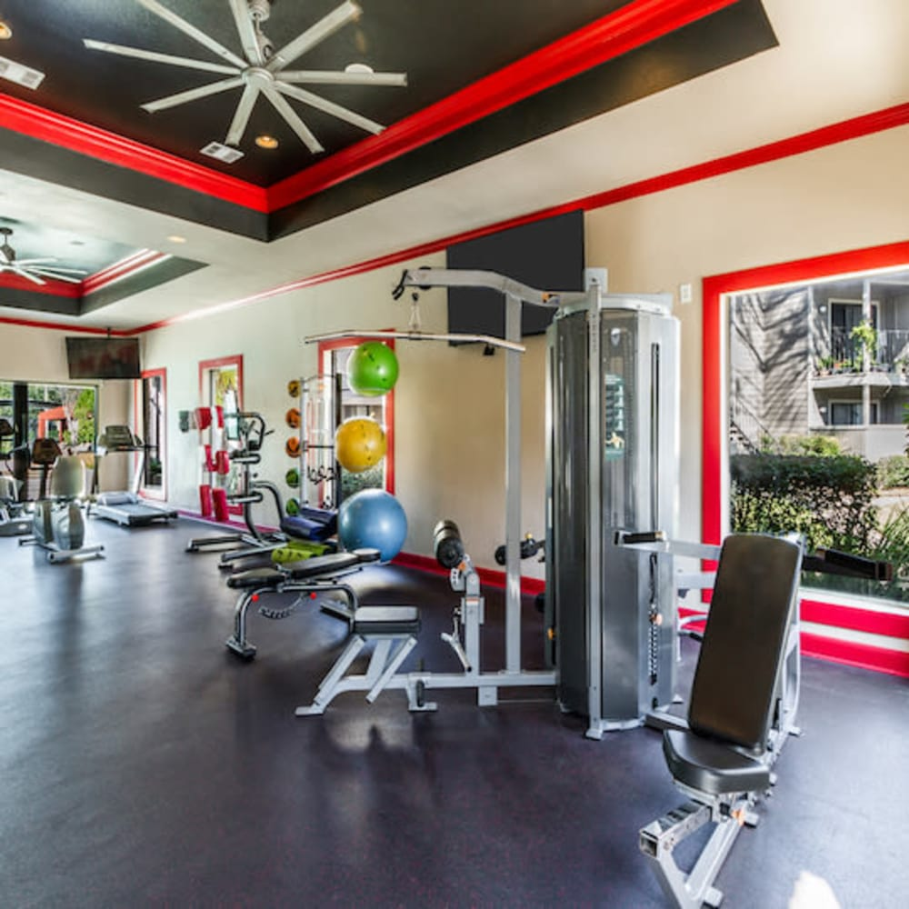 Equipment in the fitness center at 2400 Briarwest in Houston, Texas