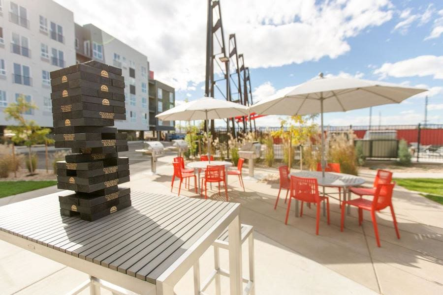 Enjoy our outdoor space with lawn games and lounge areas here at Oxford Station Apartments