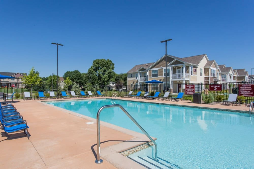 Resort Style Pool with Lounge Chairs at Springs at Egan Drive in Savage, MN