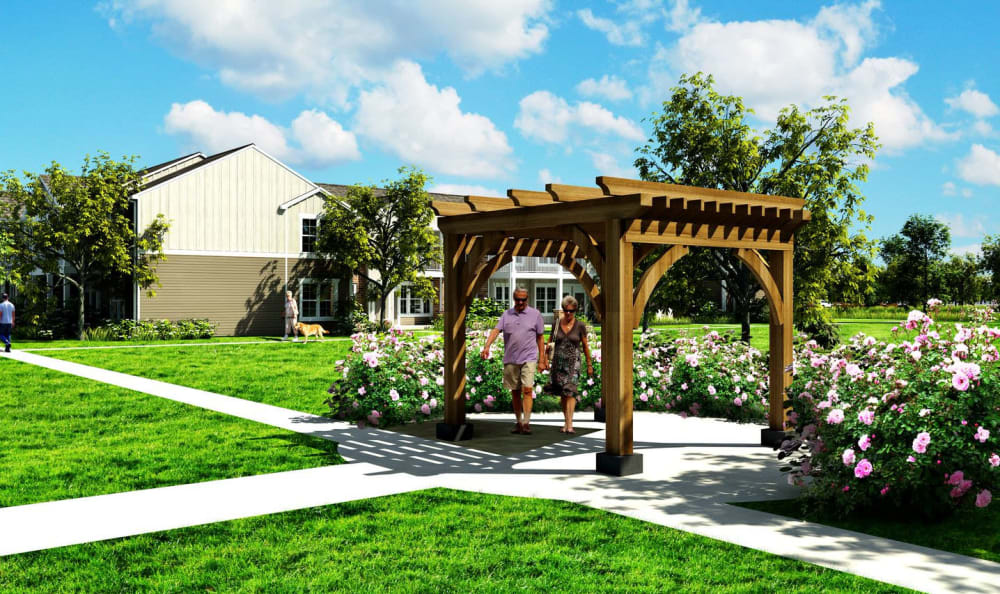 Residents enjoying a walk under the pergola at Springs at Forest Hill in Shelby County, Tennessee