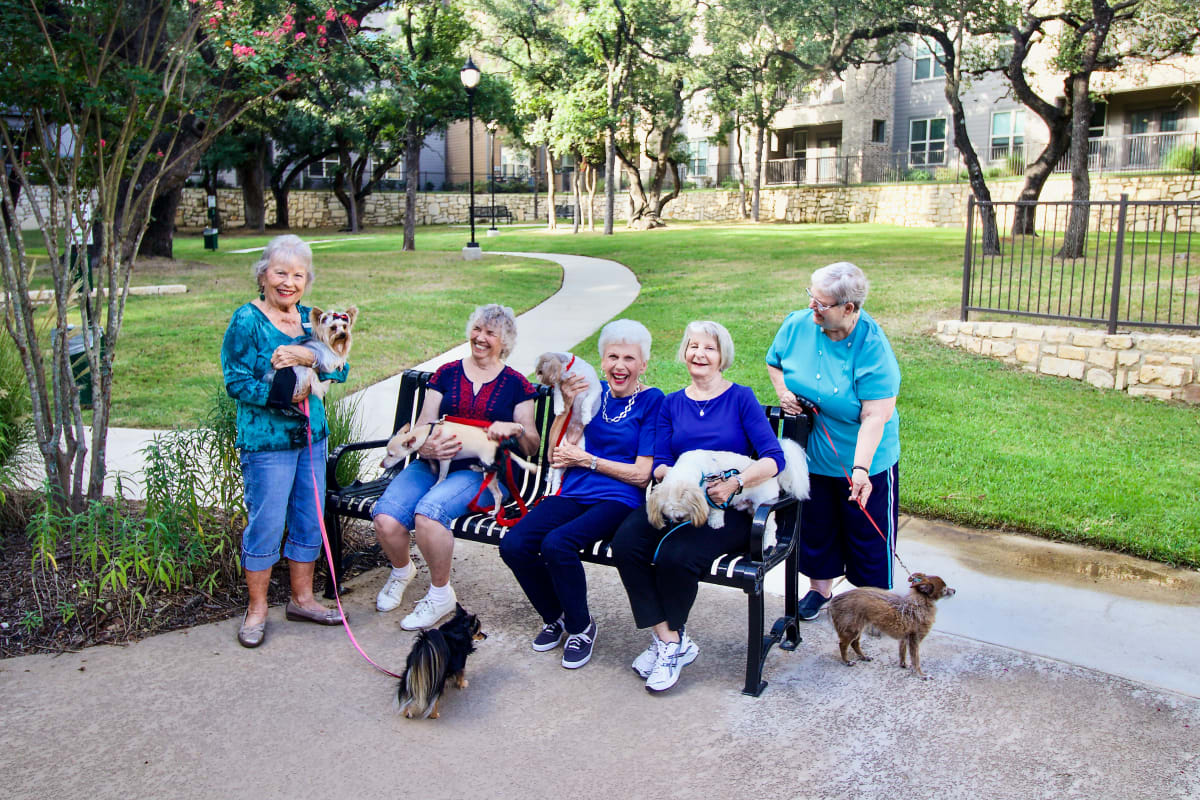Residents with their dogs at Watercrest at Mansfield in Mansfield, Texas