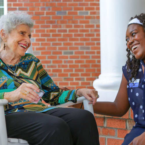 Resident and caregiver at The Crossings at Ironbridge in Chester, Virginia