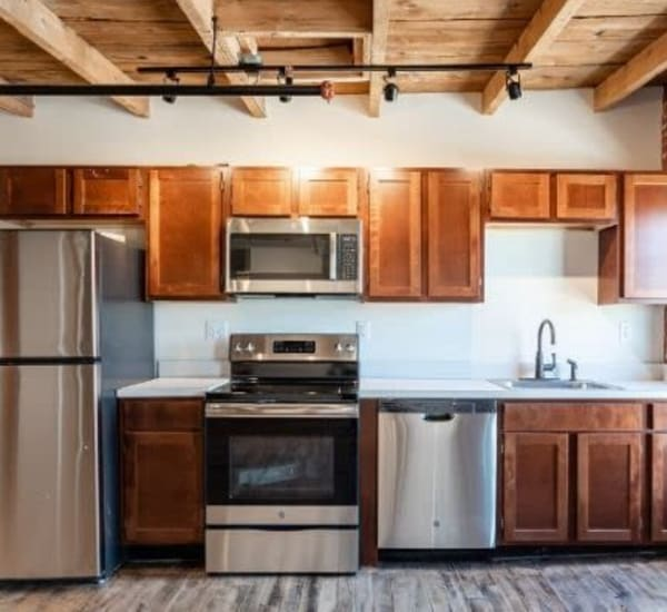 Fully equipped kitchen at Lofts at Cargill Falls Mill in Putnam, Connecticut