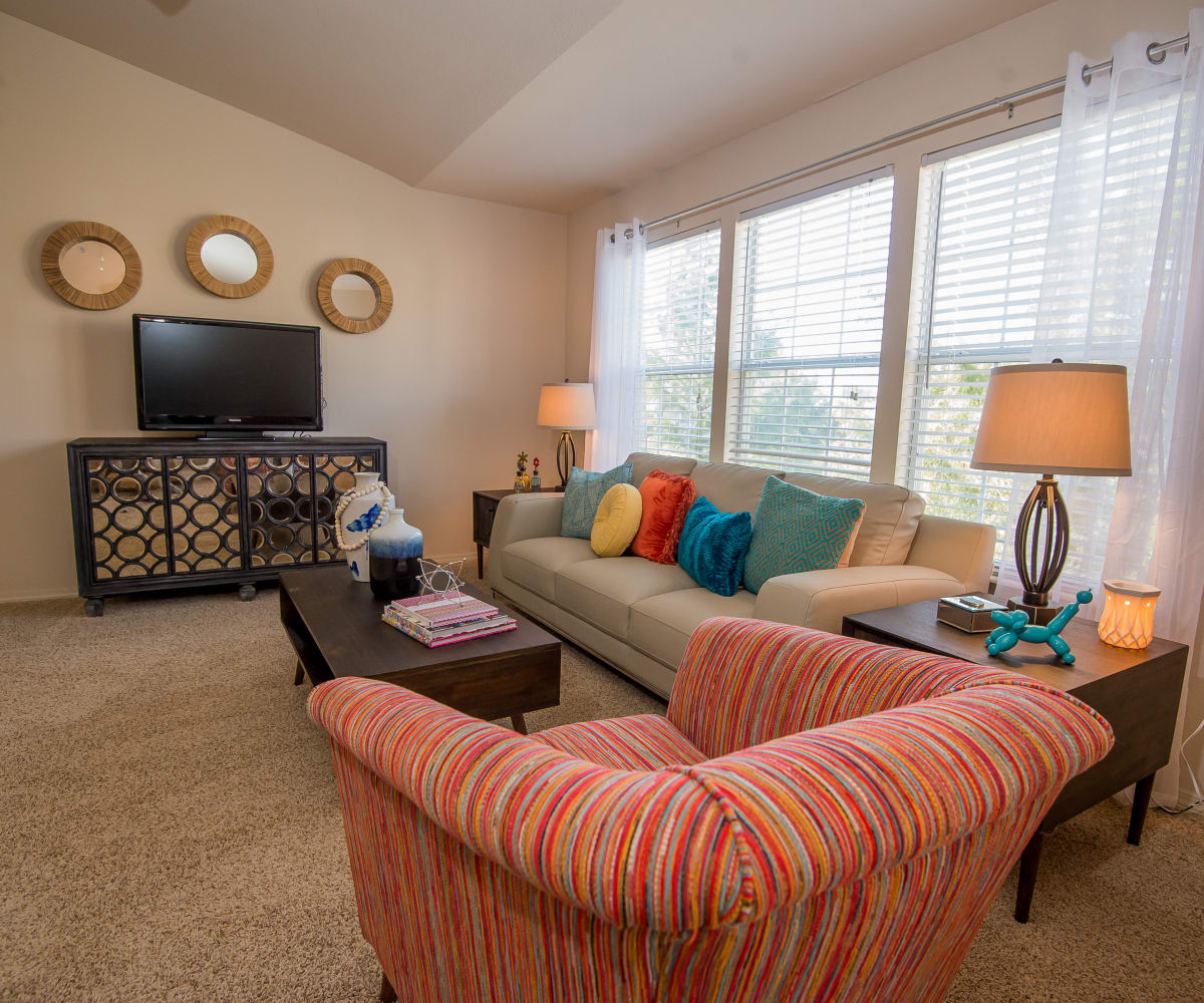 Well-lit living room at Villas at Aspen Park in Broken Arrow, Oklahoma