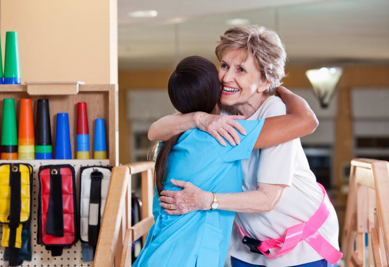 Resident and staff member hugging at Heritage Health Care in Chanute, Kansas