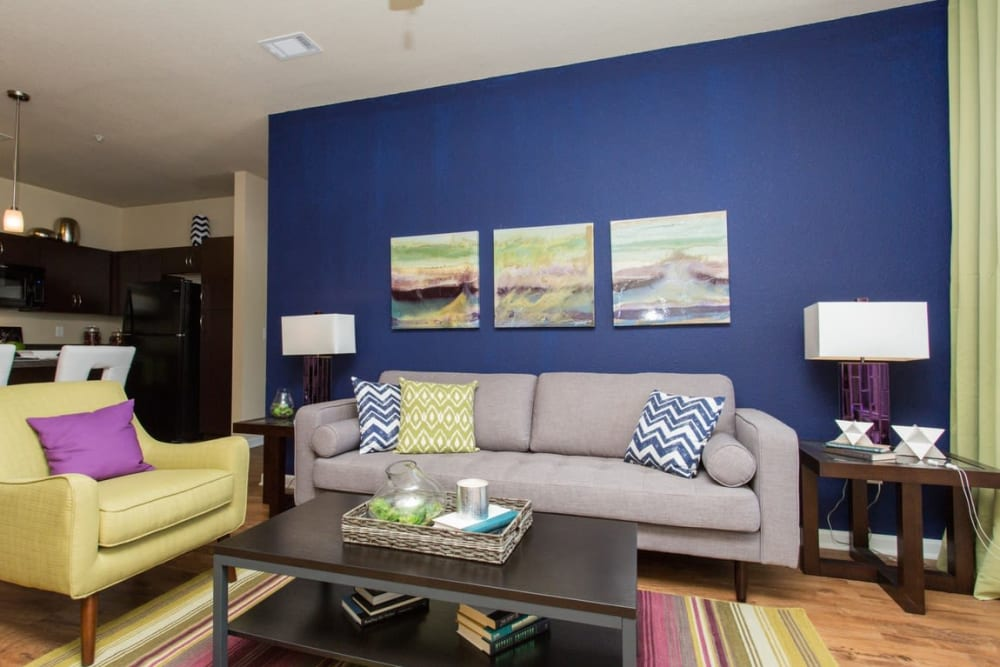 Spacious Living Room with Blue Accent Wall at Springs at Egan Drive in Savage, MN