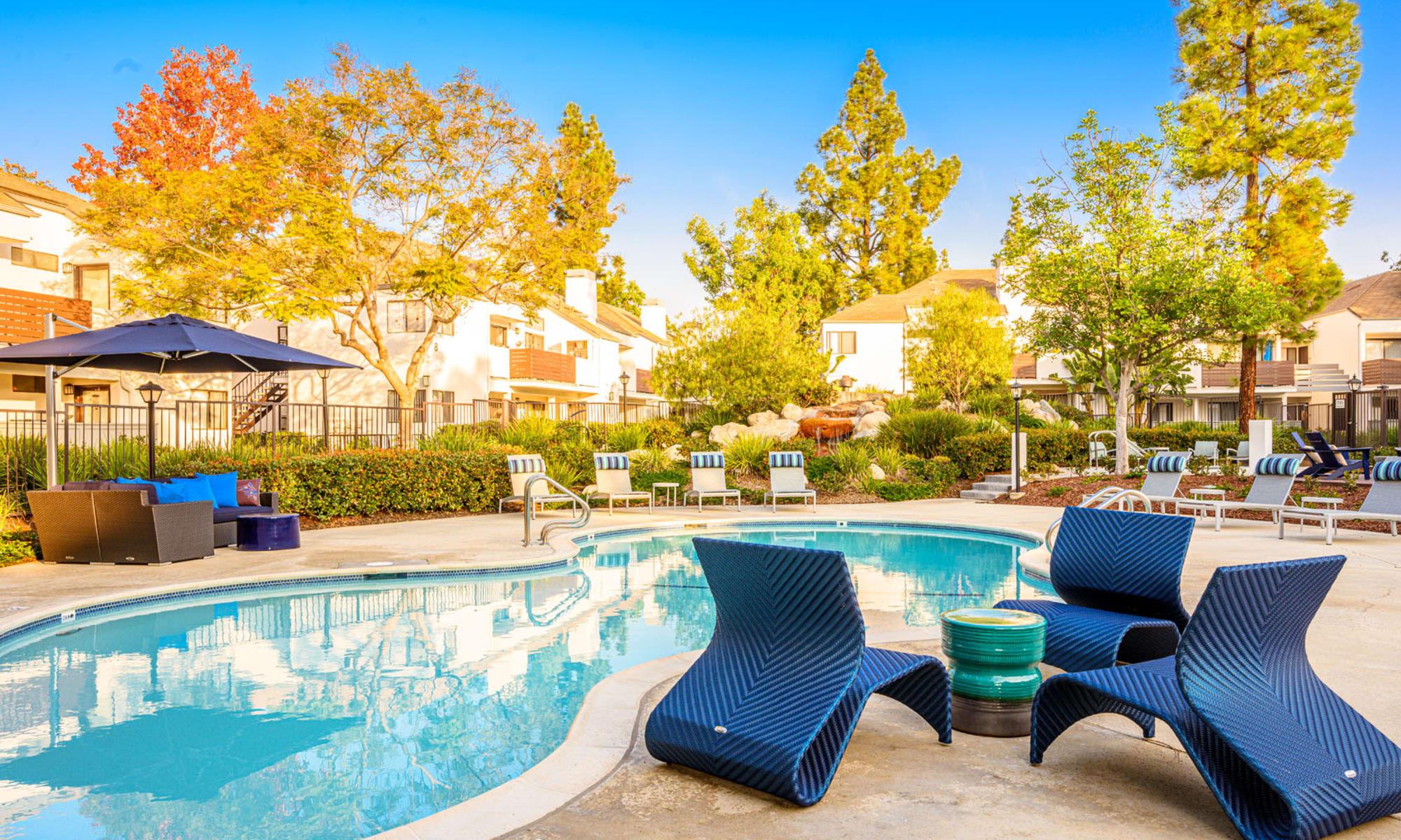 Luxurious lounge areas near the pool on a beautiful afternoon at Sendero Huntington Beach in Huntington Beach, California