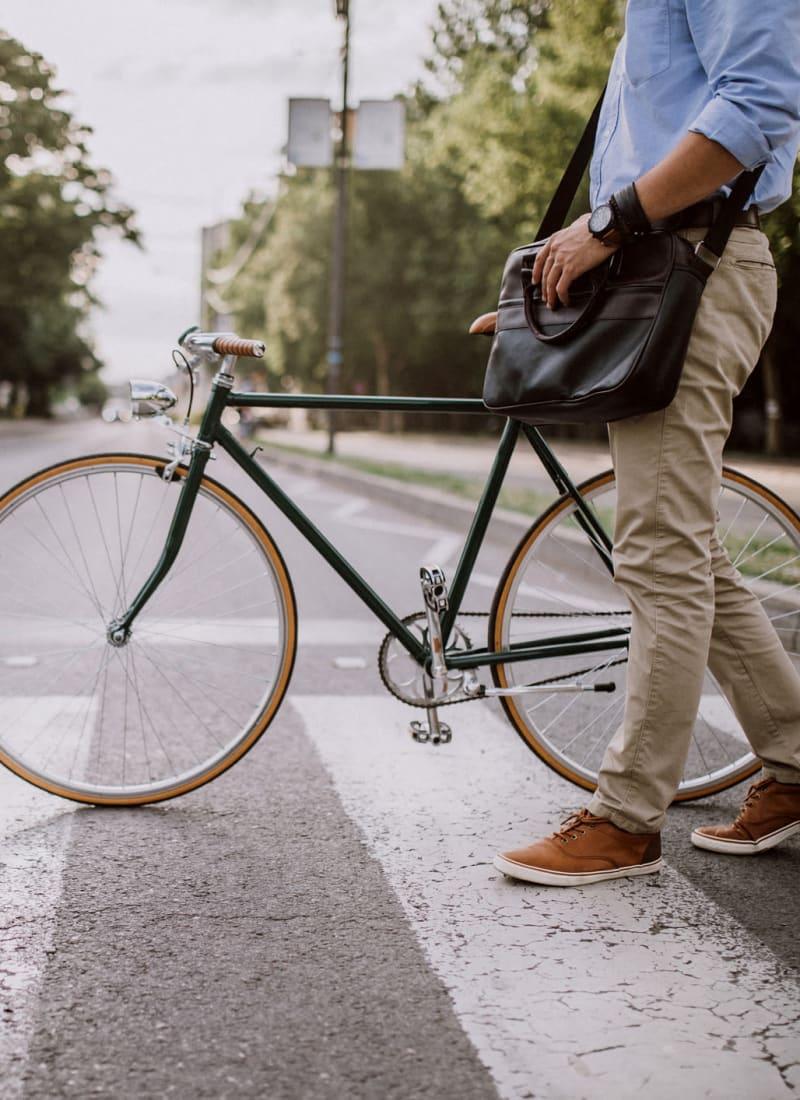 Resident walking his bike near Marquis Parkside in Austin, Texas