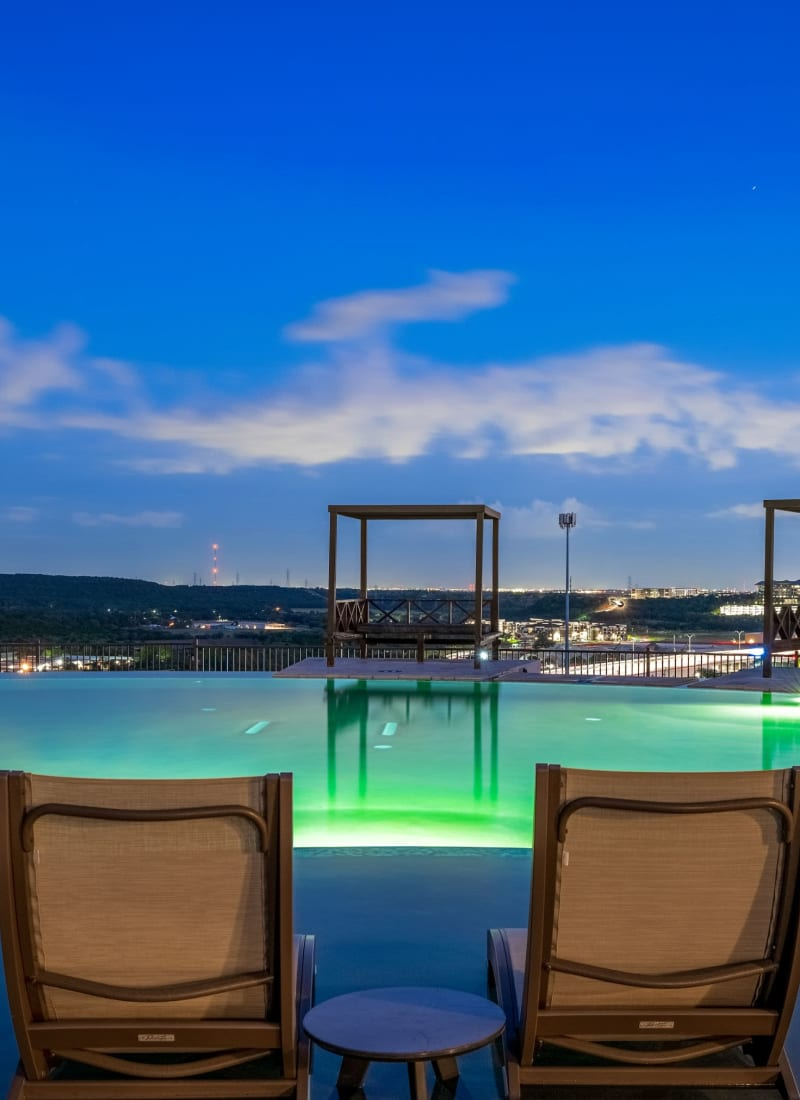 Pool chairs overlooking the city at Marquis Cresta Bella in San Antonio, Texas