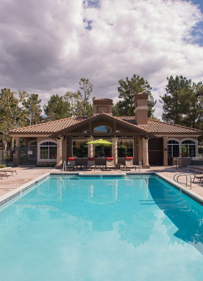 Swimming poll with a large sun deck at Paloma Summit Condominium Rentals in Foothill Ranch, California