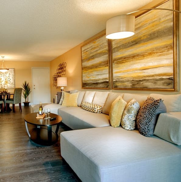Bright, well decorated living room at Avia McCormick Ranch Apartments in Scottsdale, Arizona