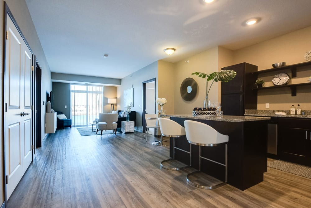 Spacious layout with wood-style flooring at Remington Cove Apartments in Apple Valley, Minnesota