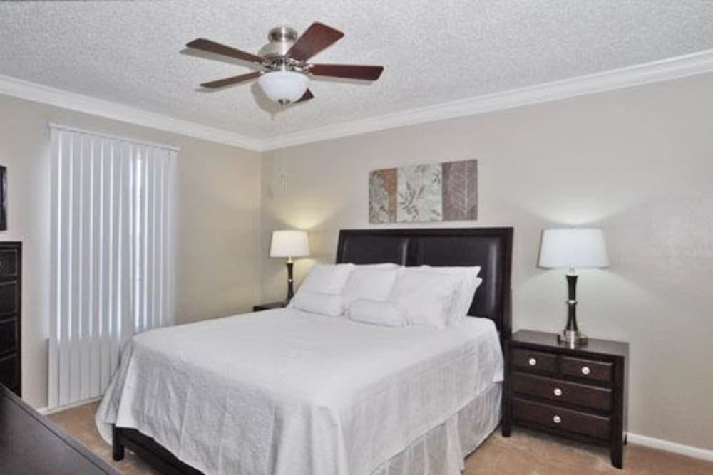 Enjoy a cozy bedroom at French Colony Apartments in Lafayette, Louisiana