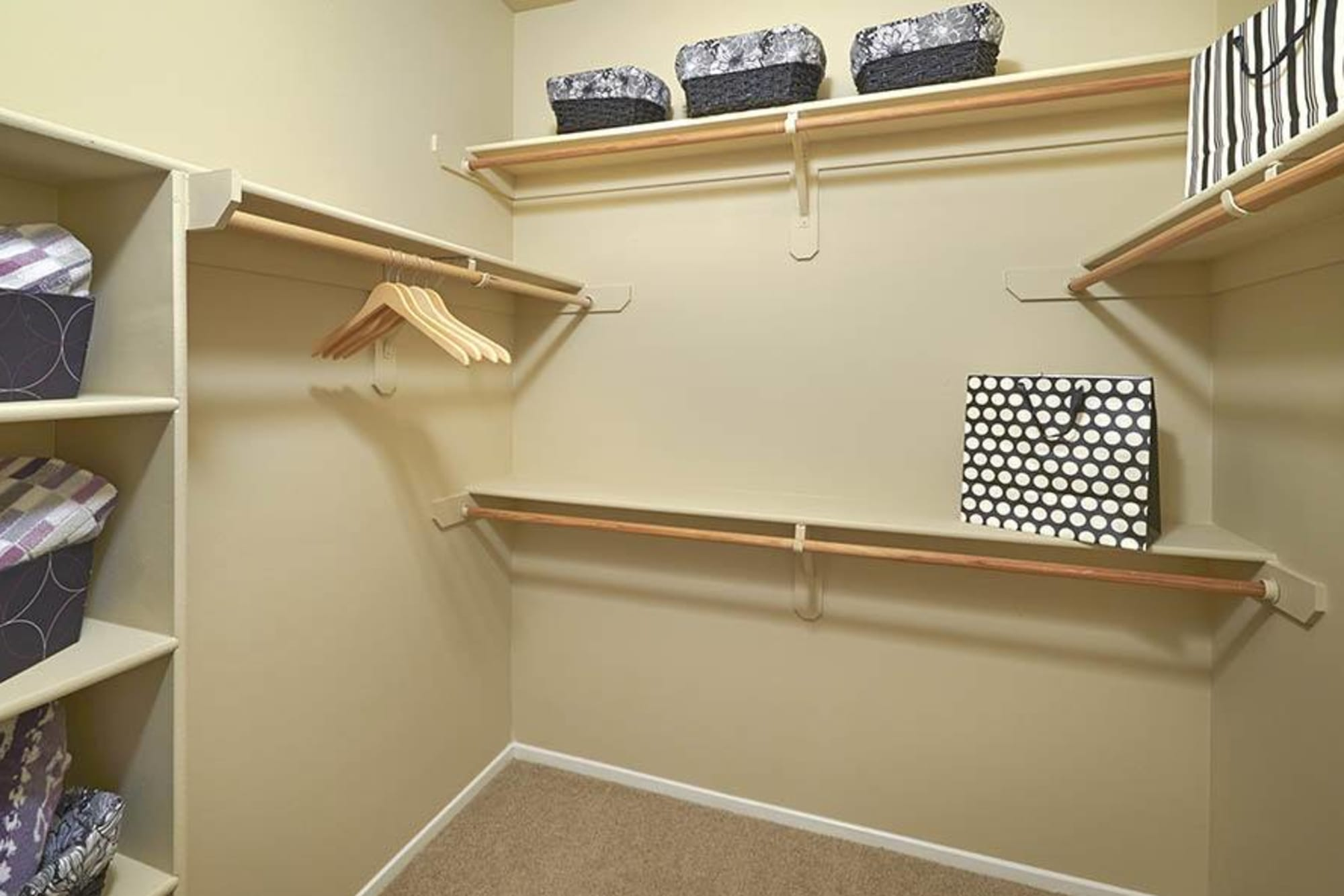 Master bedroom walk-in closet at Legend Oaks Apartments in Aurora, Colorado