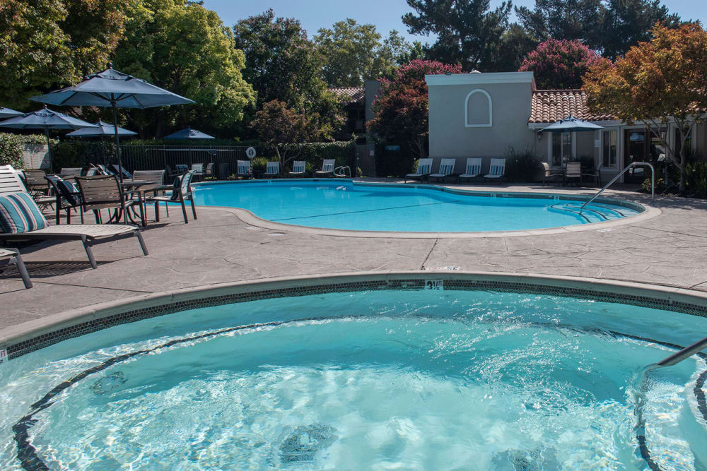 Resort-style swimming pool at La Valencia Apartment Homes in Campbell, California