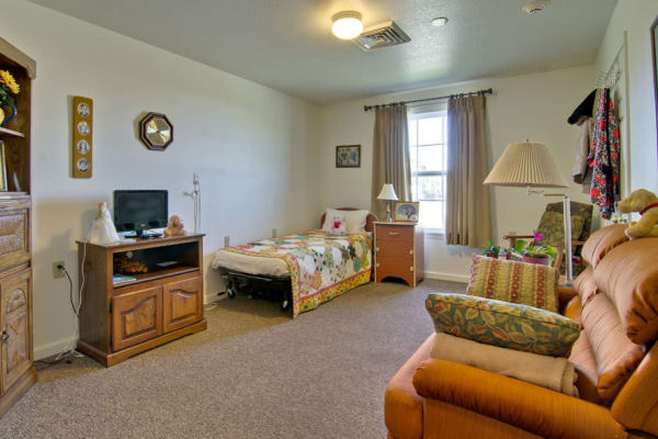 Assisted living apartment bedroom at Silver Creek Senior Living in Joplin, Missouri