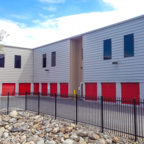 Exterior storage units with red doors at StorQuest Self Storage in Reno, Nevada