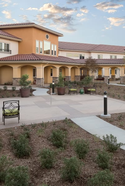 Exterior view of Estancia Del Sol in Corona, California featuring beautiful landscaping