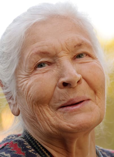 Resident enjoying living in comfort at MuirWoods Memory Care