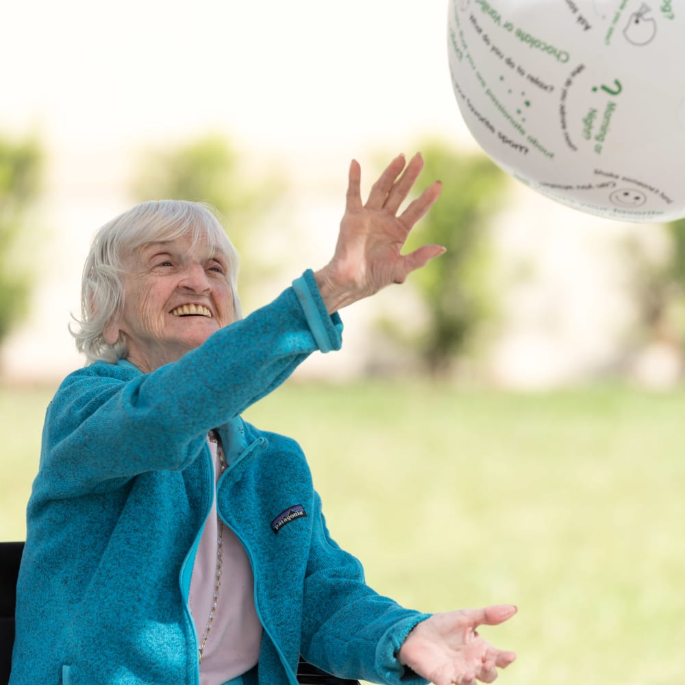 Resident playing with a ball at Inspired Living Ivy Ridge in St Petersburg, Florida
