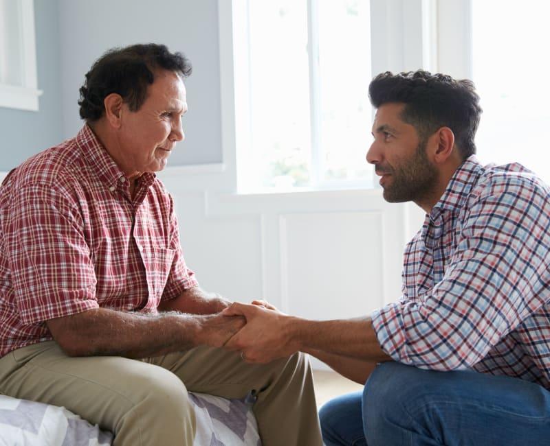 Resident talking to his son at York Gardens in Edina, Minnesota