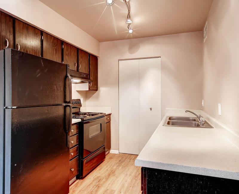 Model kitchen with dark cabinets at Arvada Village Apartment Homes in Arvada, Colorado